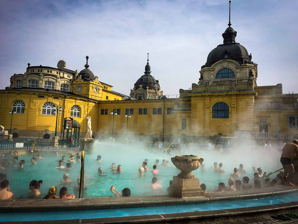 Szechenyi_Baths_yellow building with steam coming off a pool