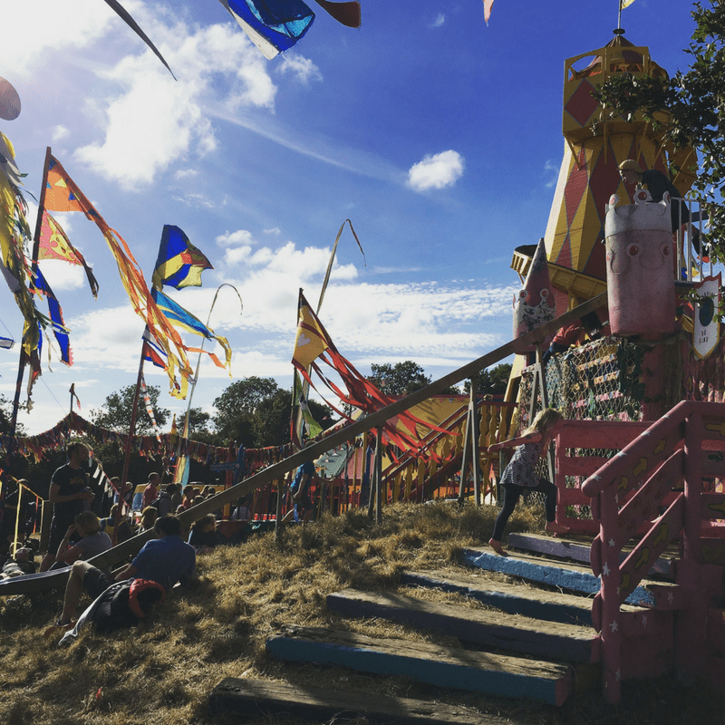 the kids field slide at glastonbury festival on a sunny day