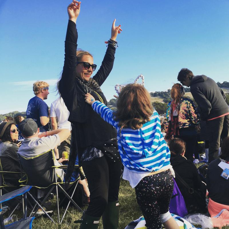 karen quinn and daughter dancing to live music at glastonbury festival