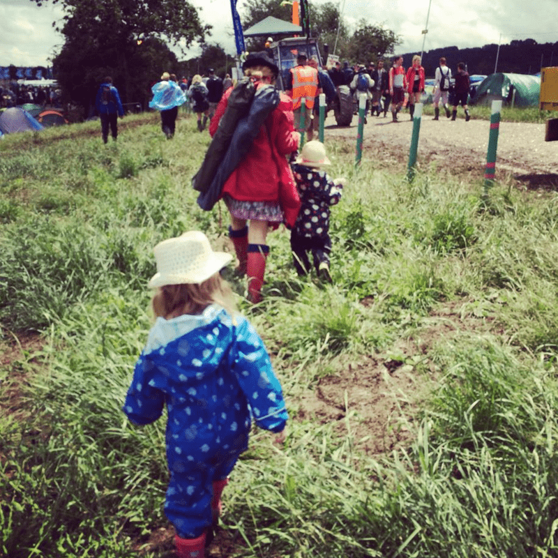 kids walking through the field at a music festival