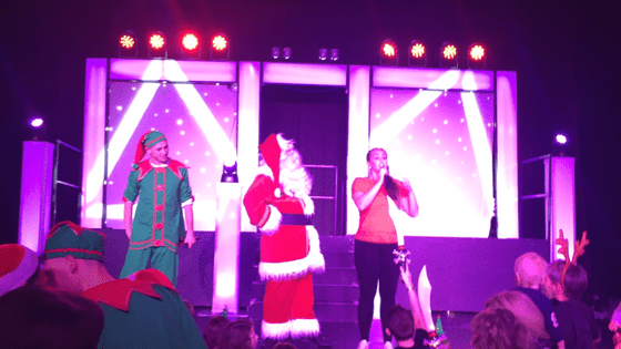 Santa on stage with his elves at the macdonald aviemore hotel