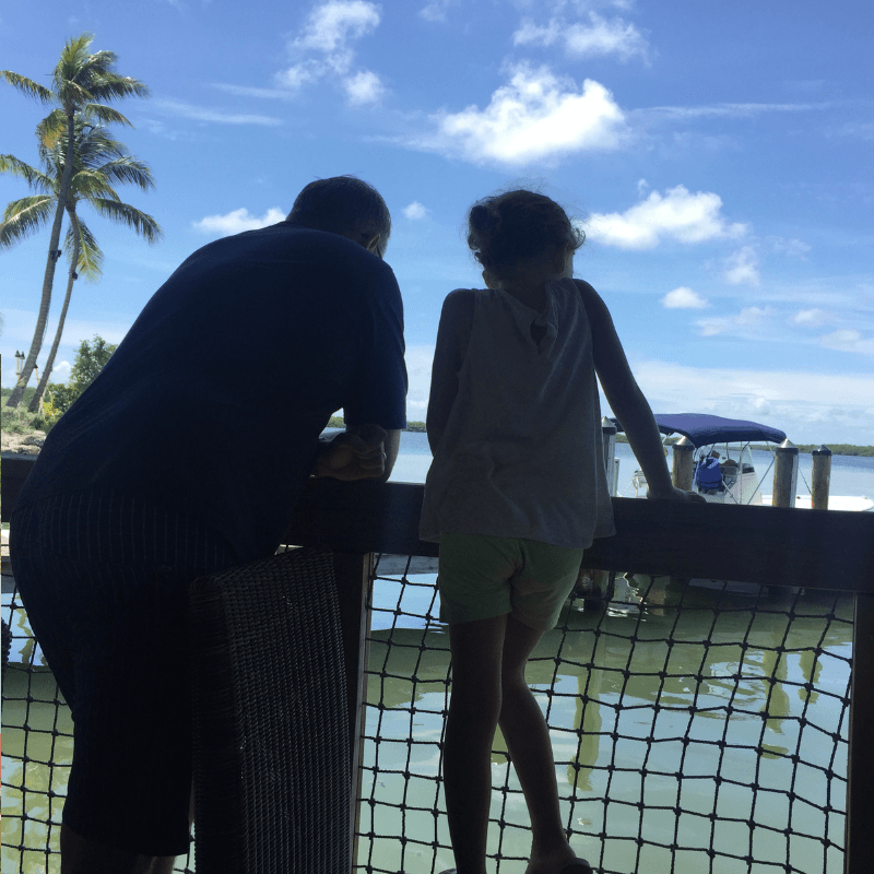 daddy and daughter looking out to sea in the Florida Keys