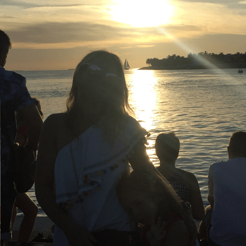 mother and daughter enjoying the sunset at mallory square in key west