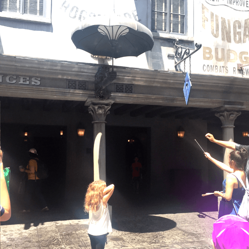 spell casting with interactive wands at the wizarding world of harry potter, universal studios