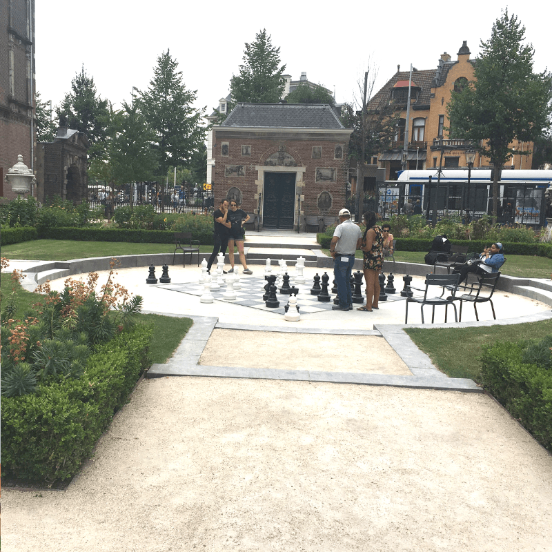 people playing chess outside the rijksmuseum in amsterdam