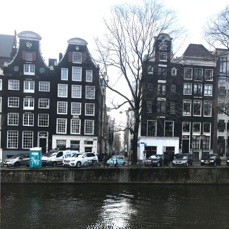 traditional style ditch buildings in amsterdam