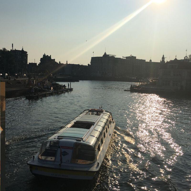 boat on river in amsterdam