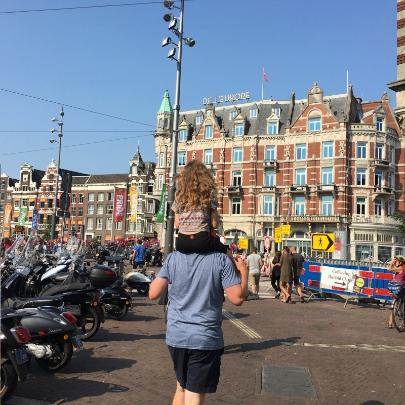 tween girl on daddy shoulders heading back to amsterdan central