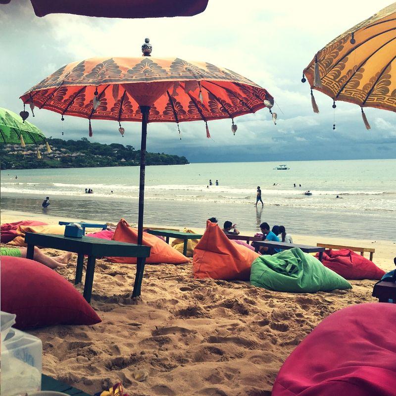colourful parasols and beanbags on jimbaran beach