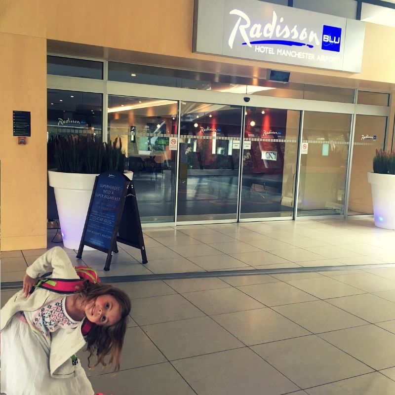 girl outside radisson hotel at manchester airport