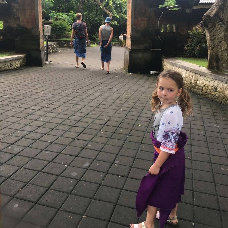 girl about to enter monkey temple in Bali, indonesia