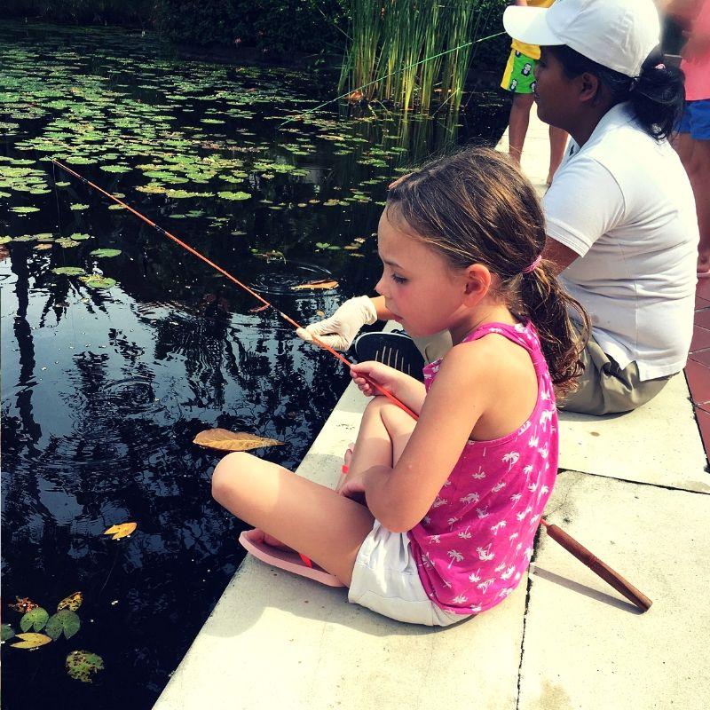 blonde girl sat fishing at the westin hotel in Bali