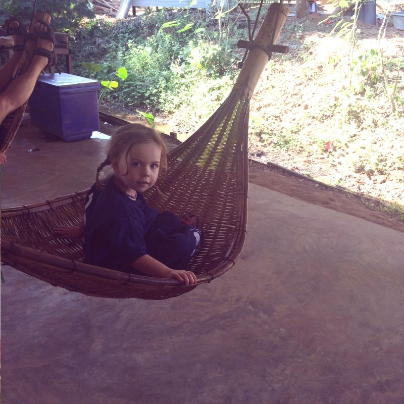 piper quinn sitting in a hammock in chiang mai, thailand
