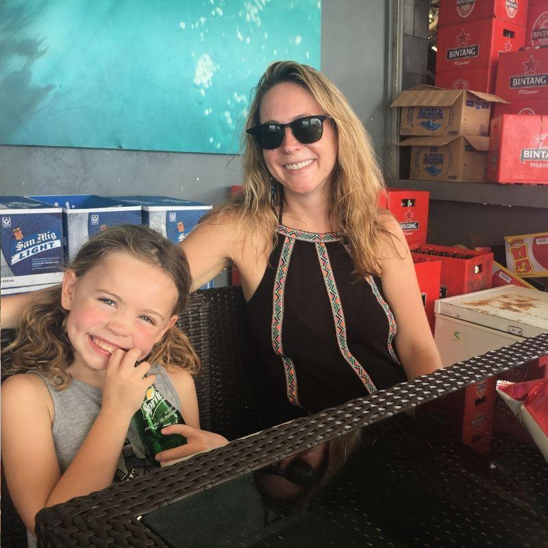 karen quinn and daughter smiling at camera in bar in uluwatu bali