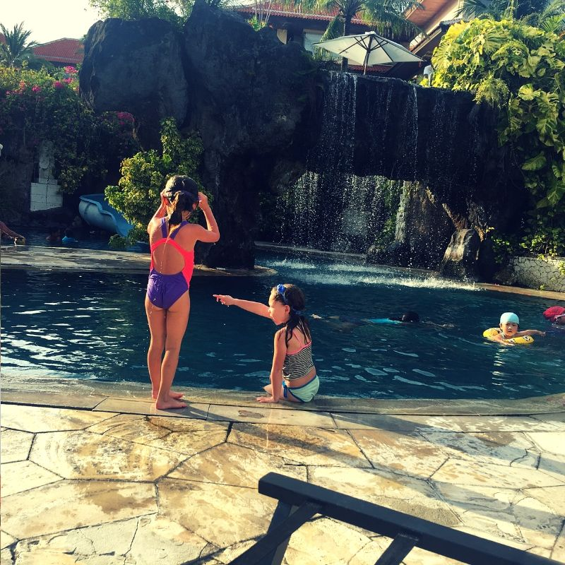 children playing in pool at westin hotel in Bali