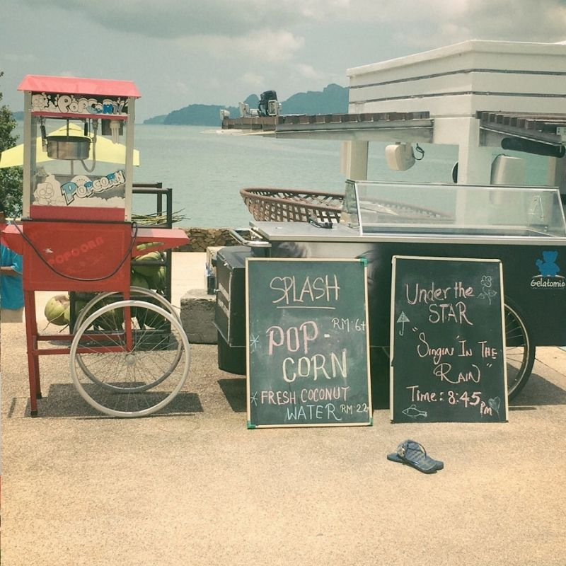 popcorn machine and sign overlooking the sea at the westin langkawi hotel