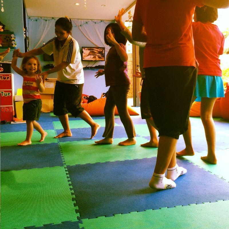 young girl practising thai dancing at the kids club in the anantara hotel in phuket