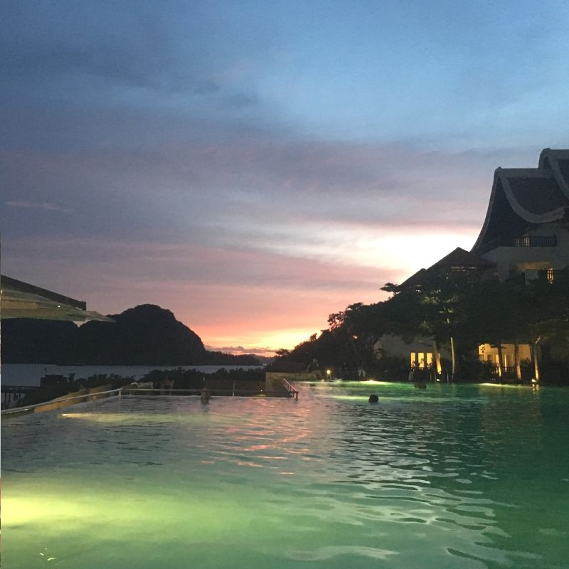 the pool at the westin hotel in langkawi as the sun sets