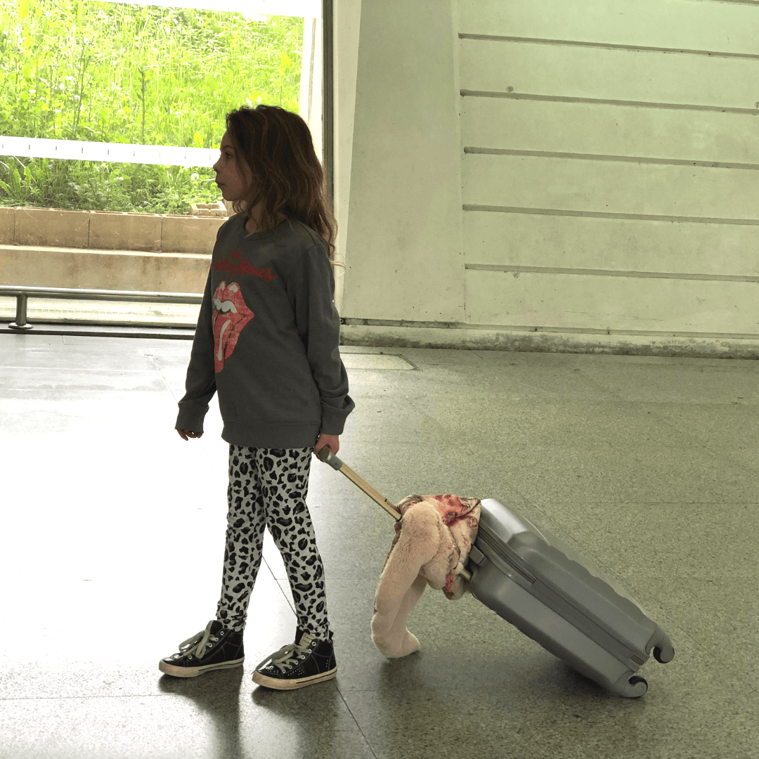 piper quinn pulling her suitcase in bilbao airport in the basque country