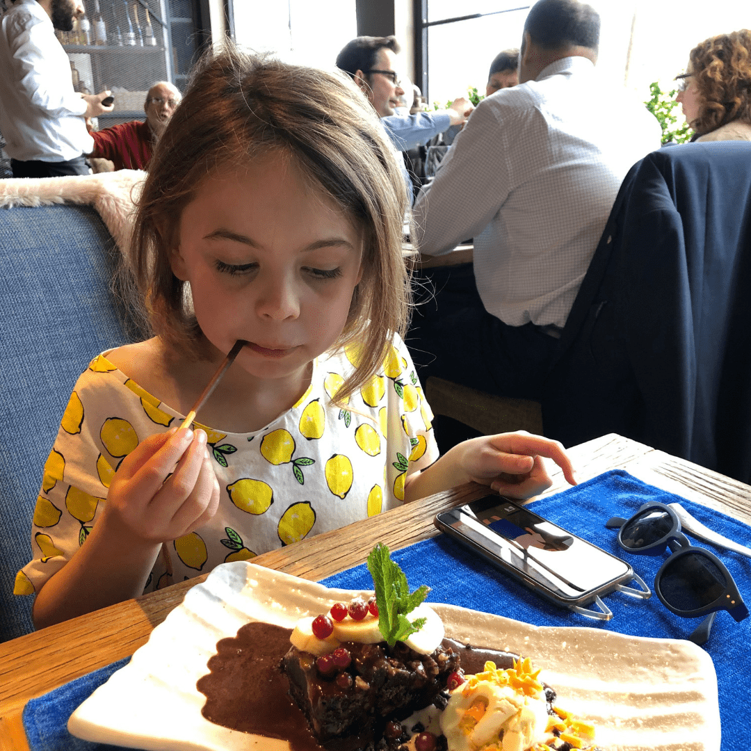 piper quinn enjoying a chocolate desert at a restaurant in the basque country