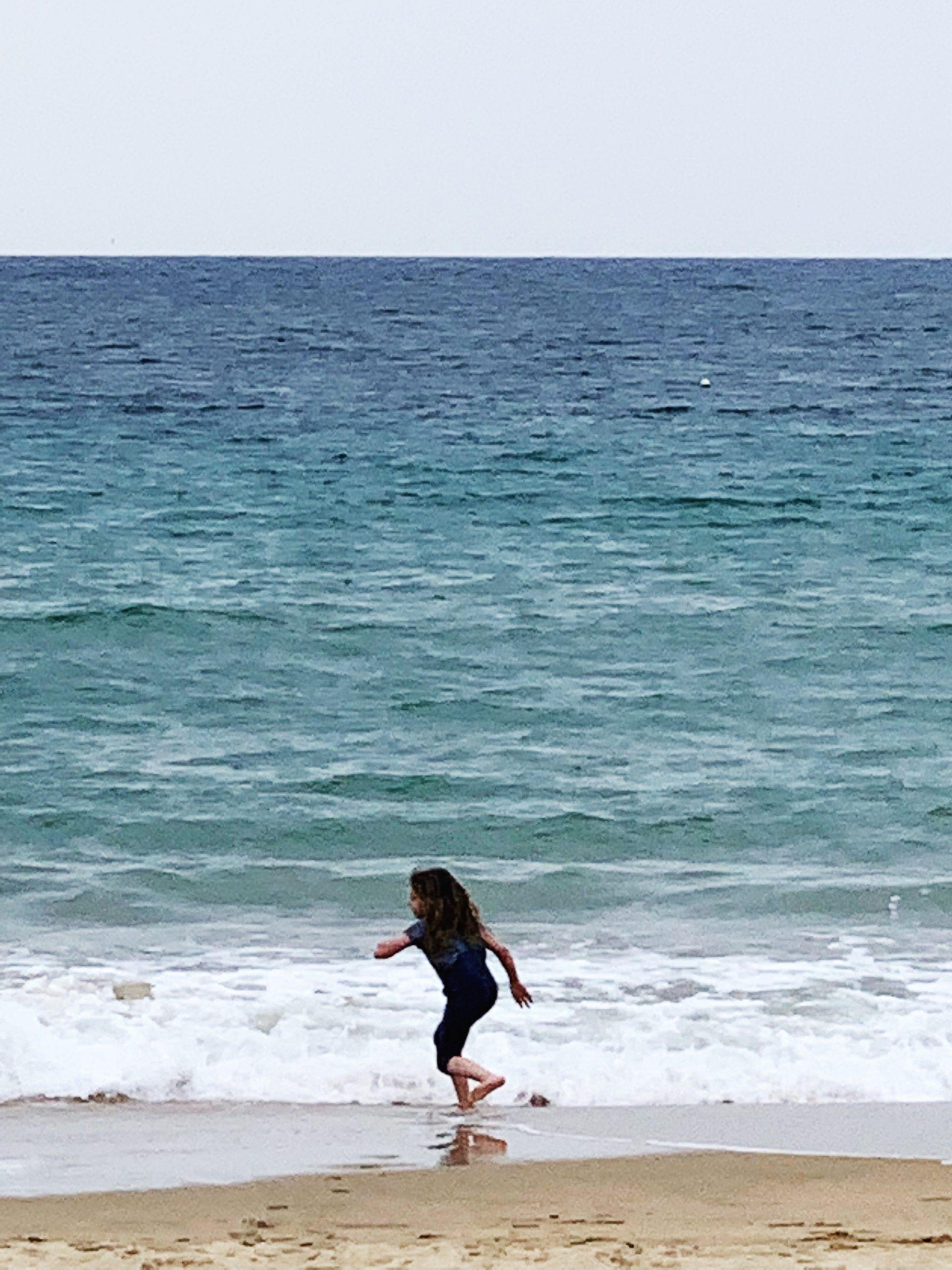 piper quinn having fun on the beach in the basque country