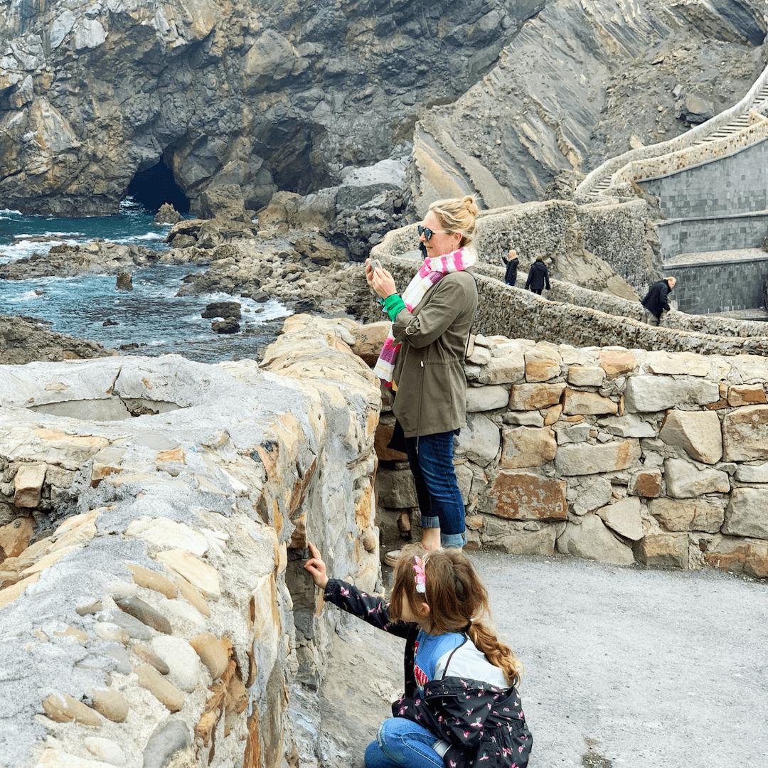 karen quinn taking a photo of Dragonstone in spain