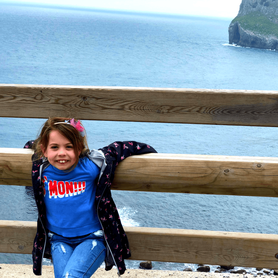 piper quinn posing infront of the sea in the basque country