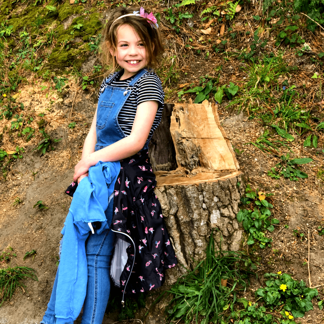8 year old piper quinn smiling in degrees at san juan de gaztelugatxe