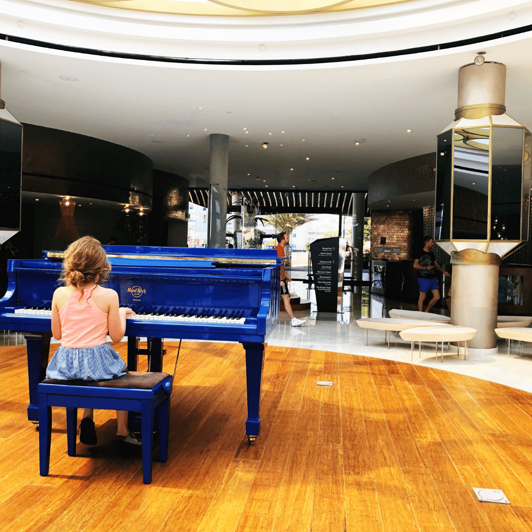 piper quinn playing a blue piano at the hard rock hotel in tenerife