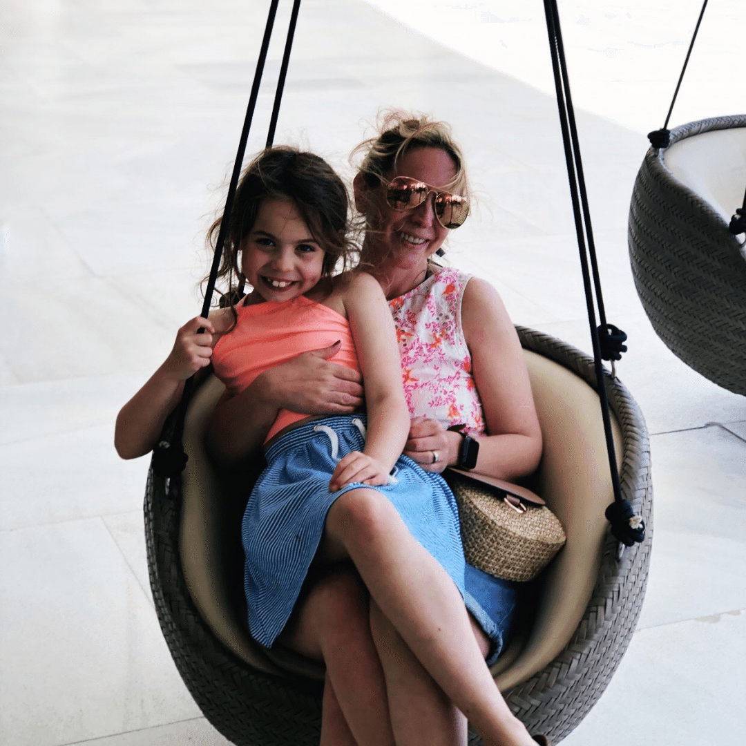 piper and karen quinn sat together on a swing seat at the hard rock hotel in tenerife