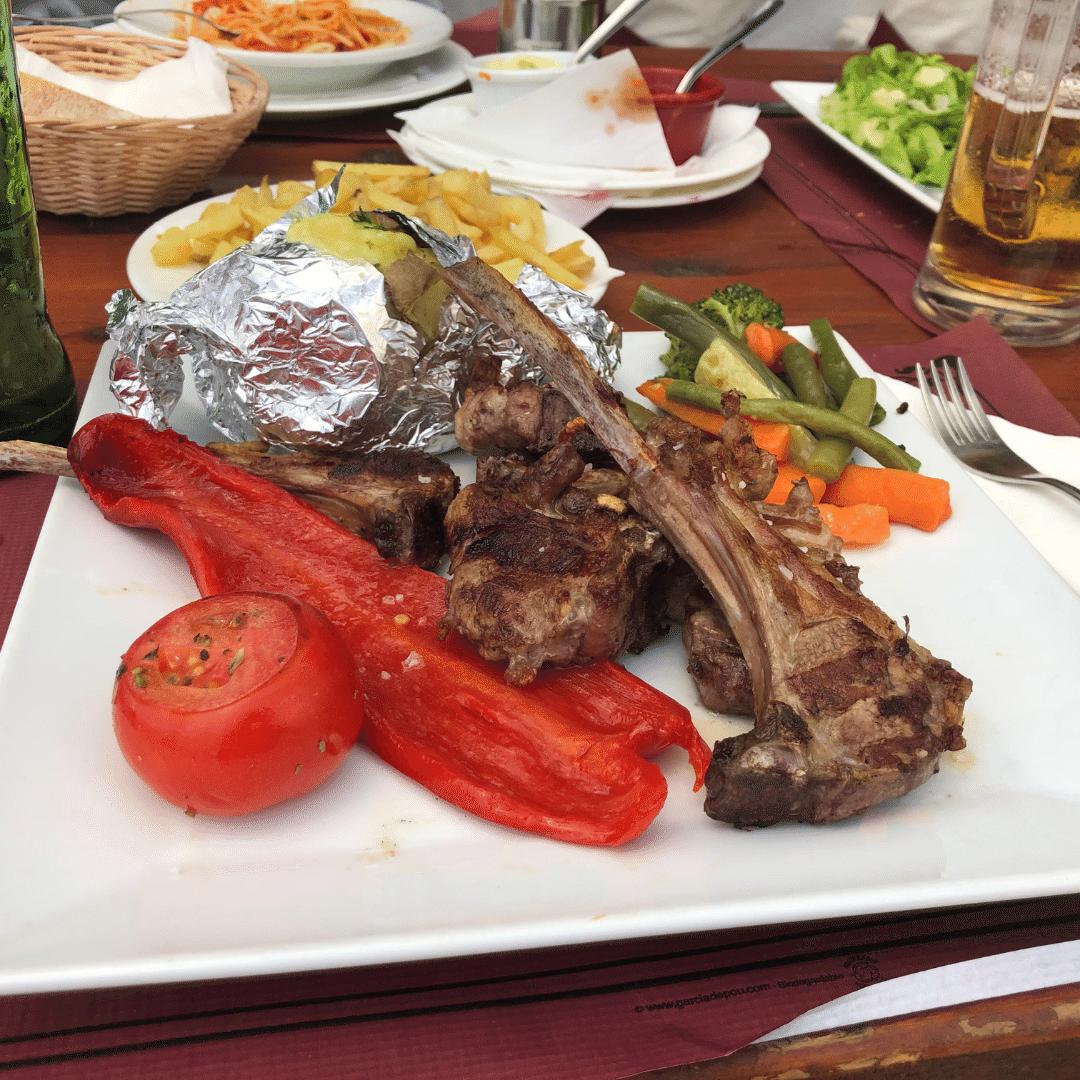 huge plate of lamb chops, vegetables and baked potato at la fink restaurant