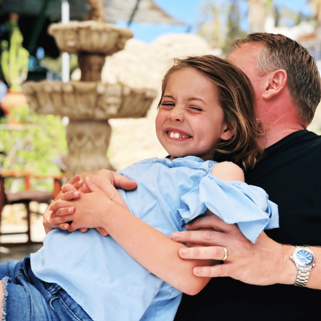 piper quinn and nigel quinn having a big happy hug on holiday in tenerife