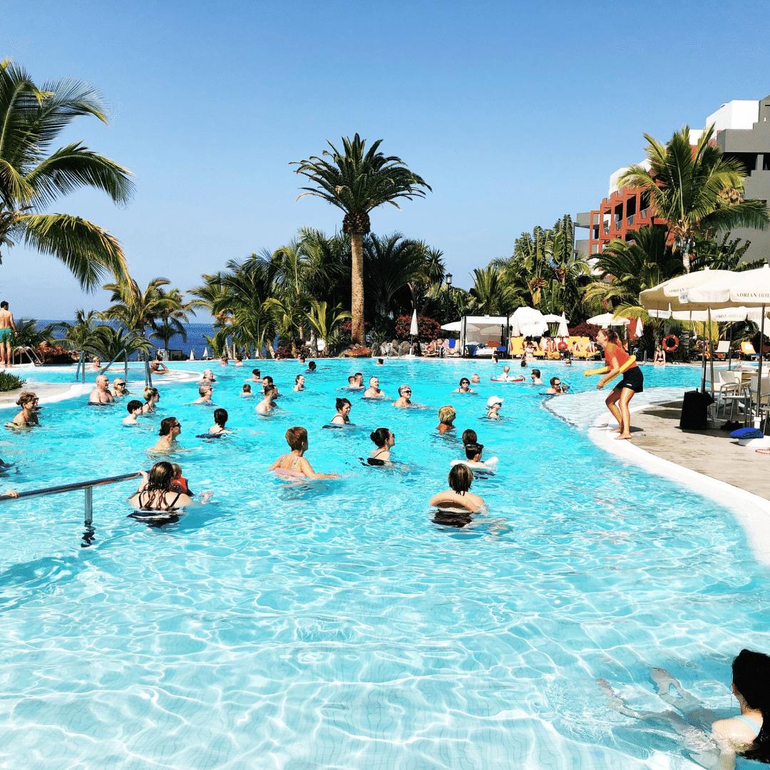 group of people doing aqua aerobics in the infinity pool at the roca nivaria hotel