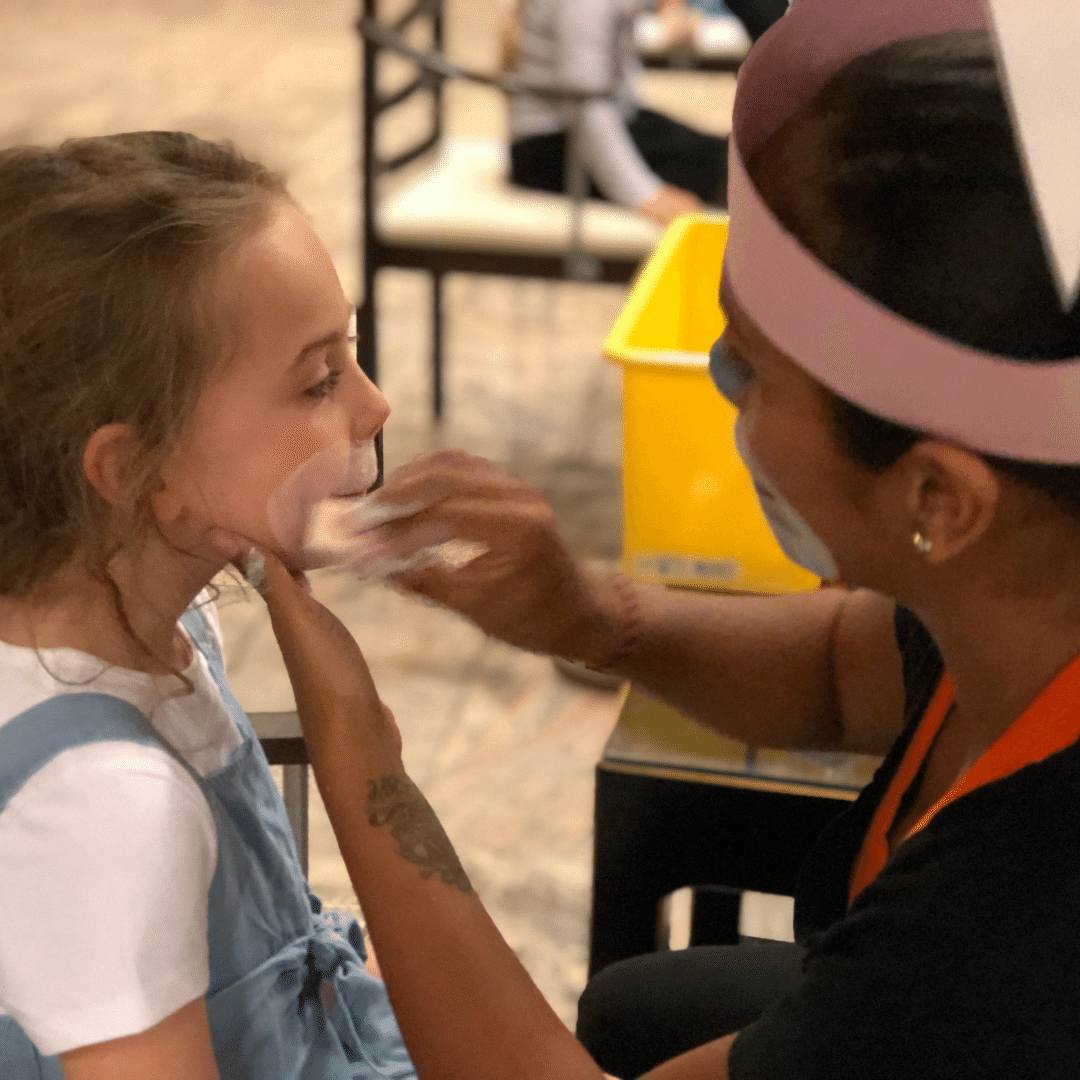 piper quinn getting her face painted as a rabbit