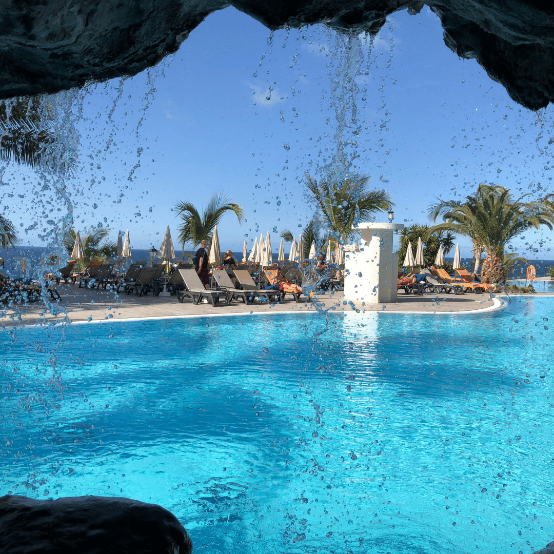 view of saltwater pool through a waterfall at the roca nivaria hotel