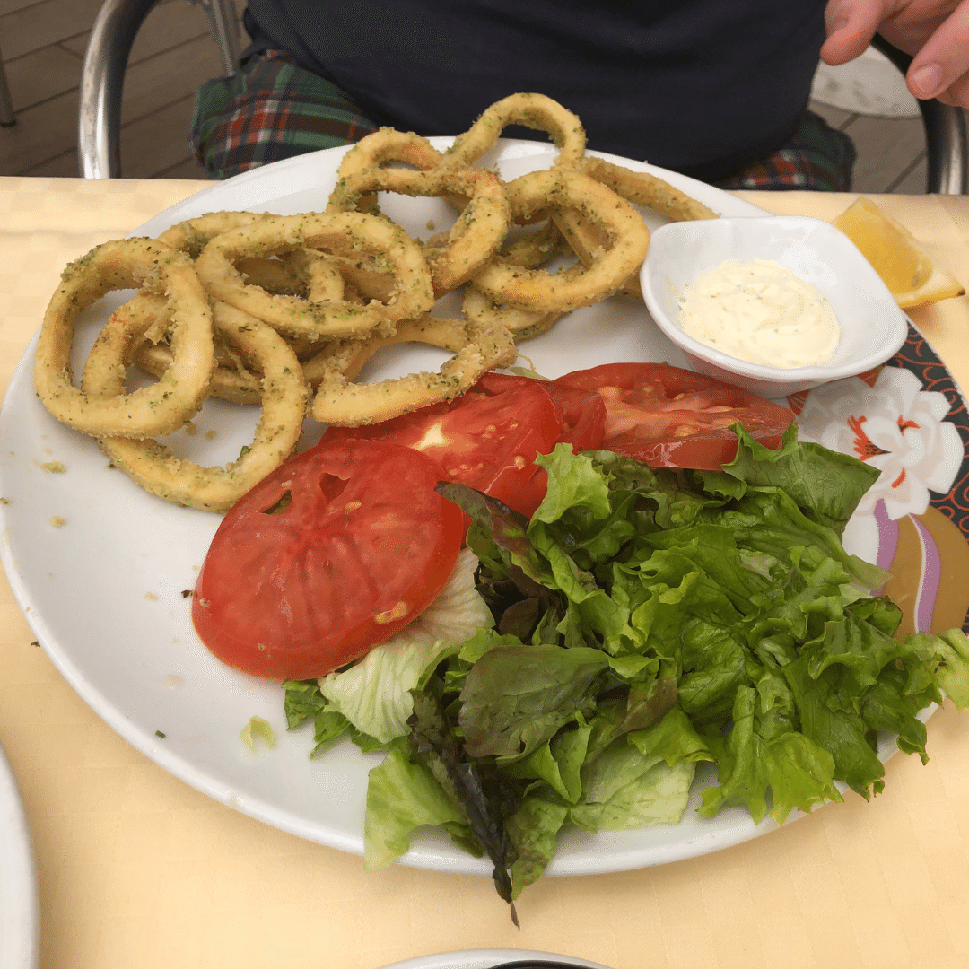 plate of calamari and fresh tomatoes