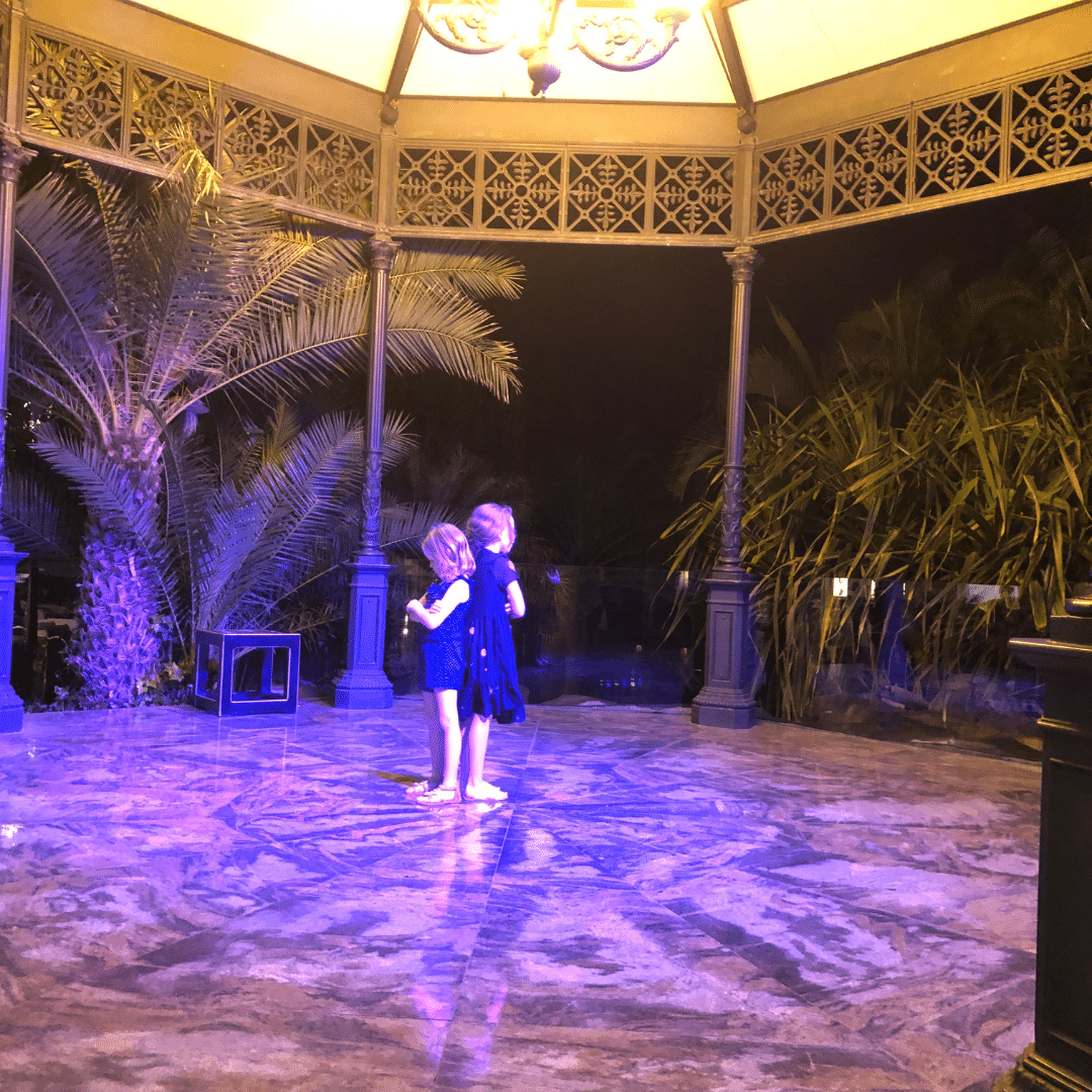 two young girls playing a game at a hotel