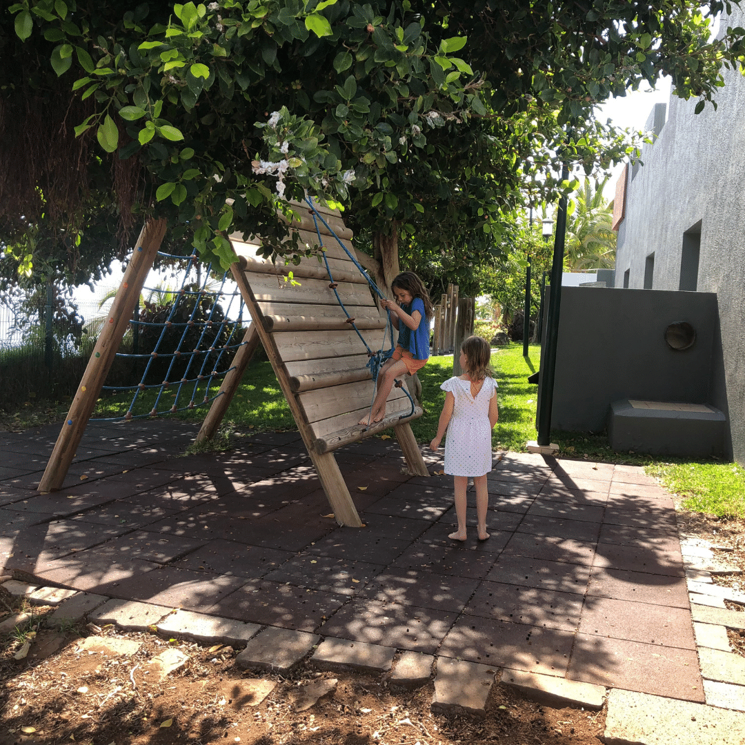 two girls playing on a climbing wall at the Roca Nivaria