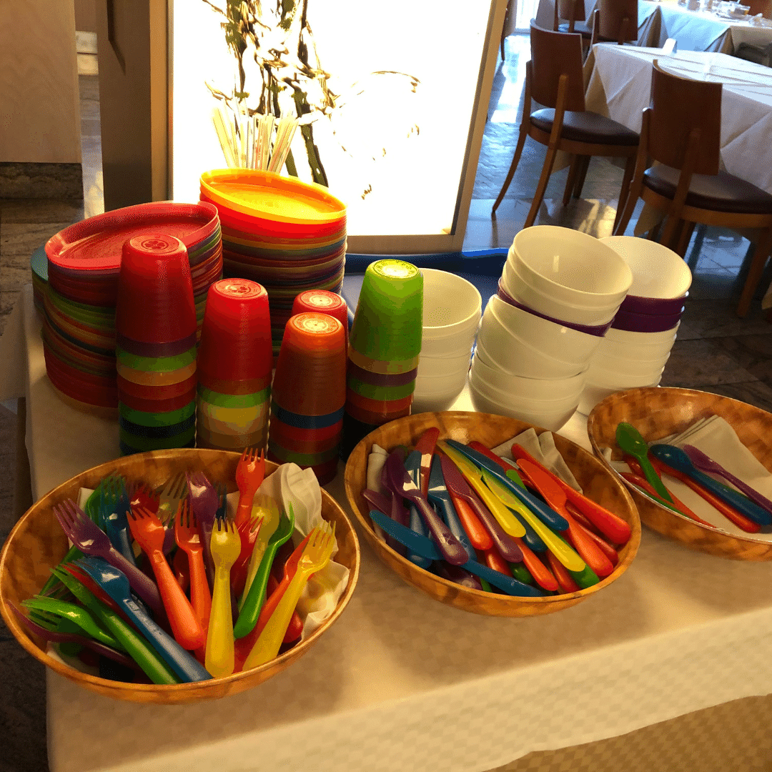 stacks of colourful plastic plates at the kids station in the roca nivaria
