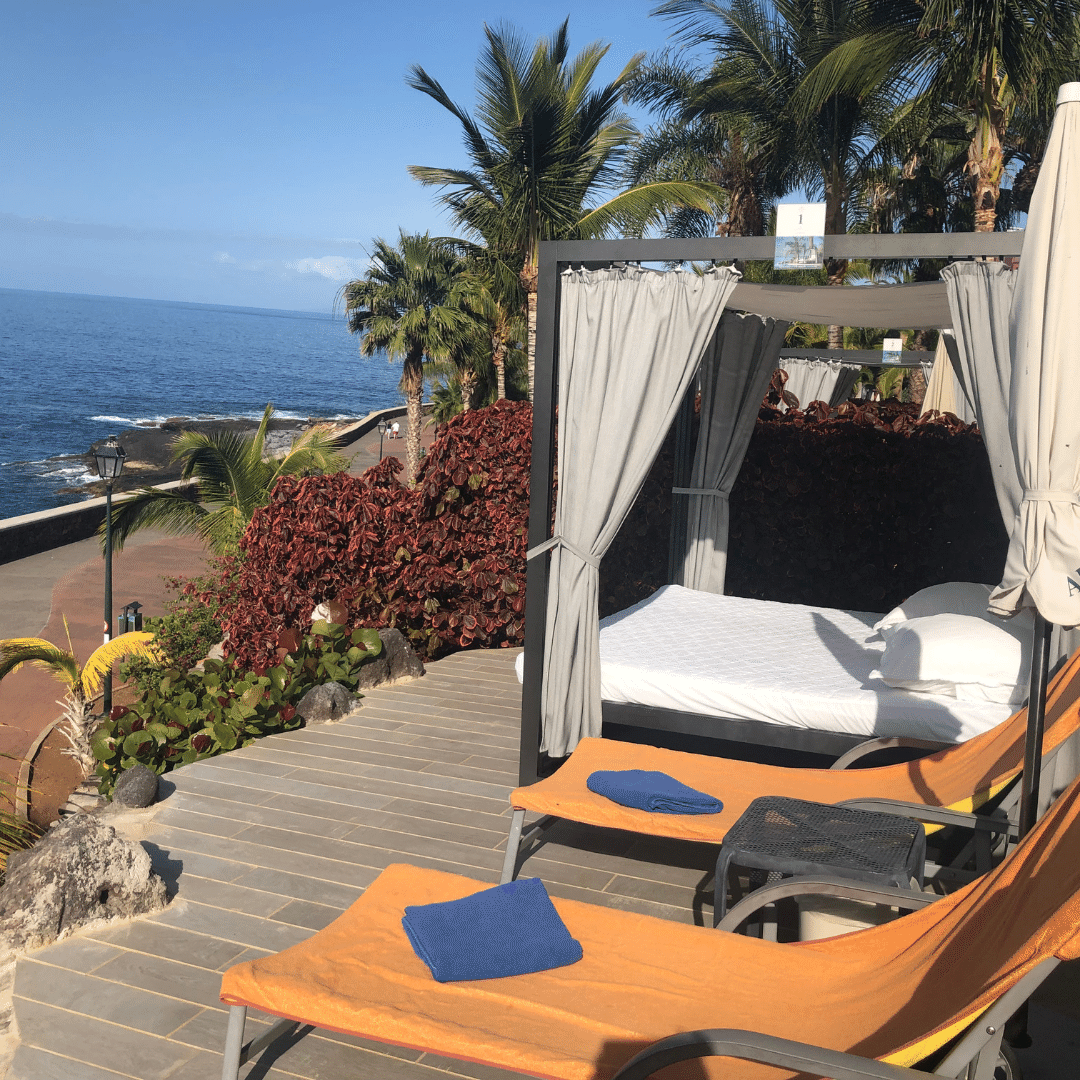 private cabana at the roca nivaria with a shaded bed and two sun loungers