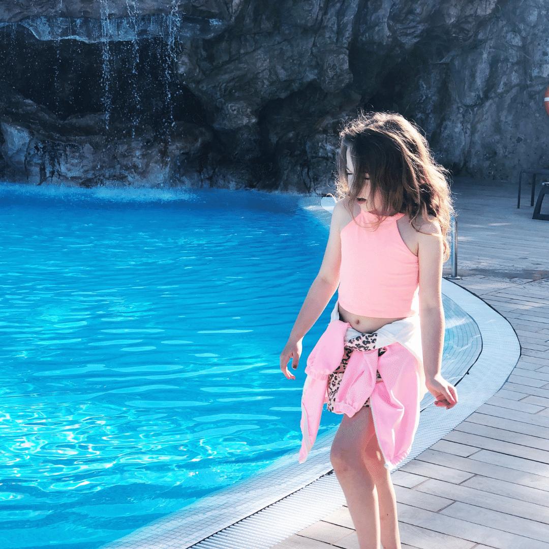 piper quinn in sports wear strolling by a pool