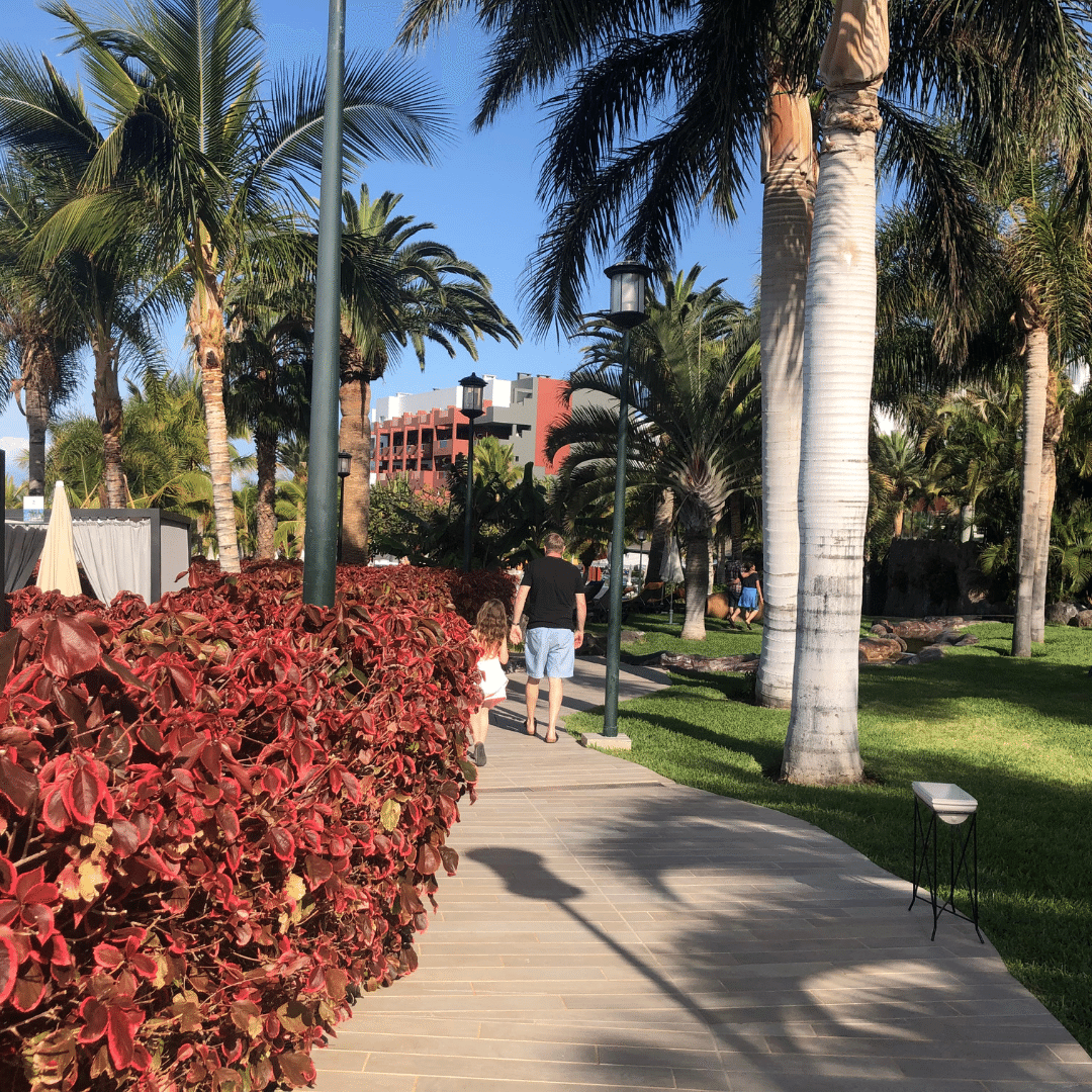 piper and nigel quinn strolling around the walkway in the roca nivaria hotel
