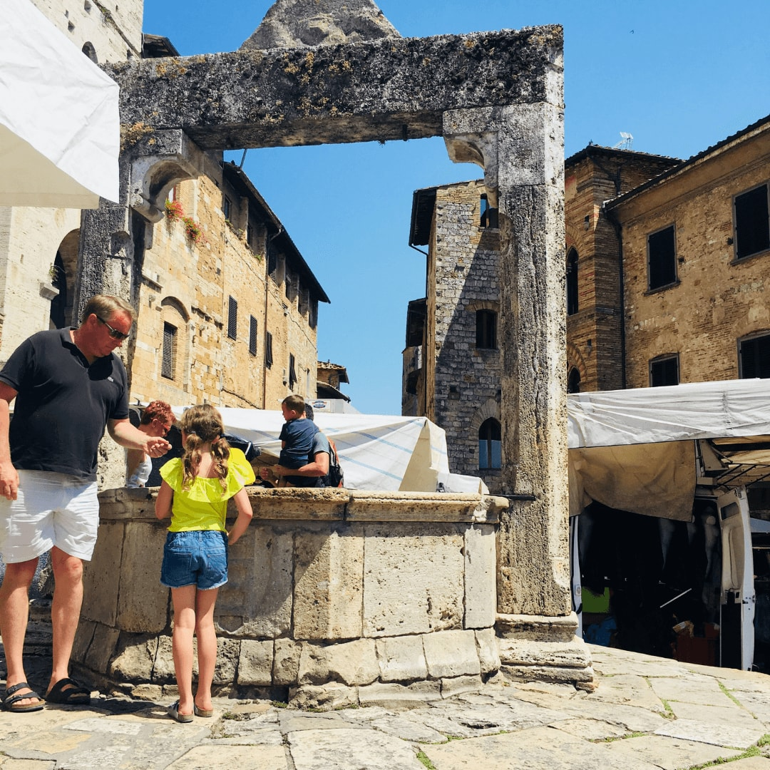 san gimignano with kids visit the wishing well