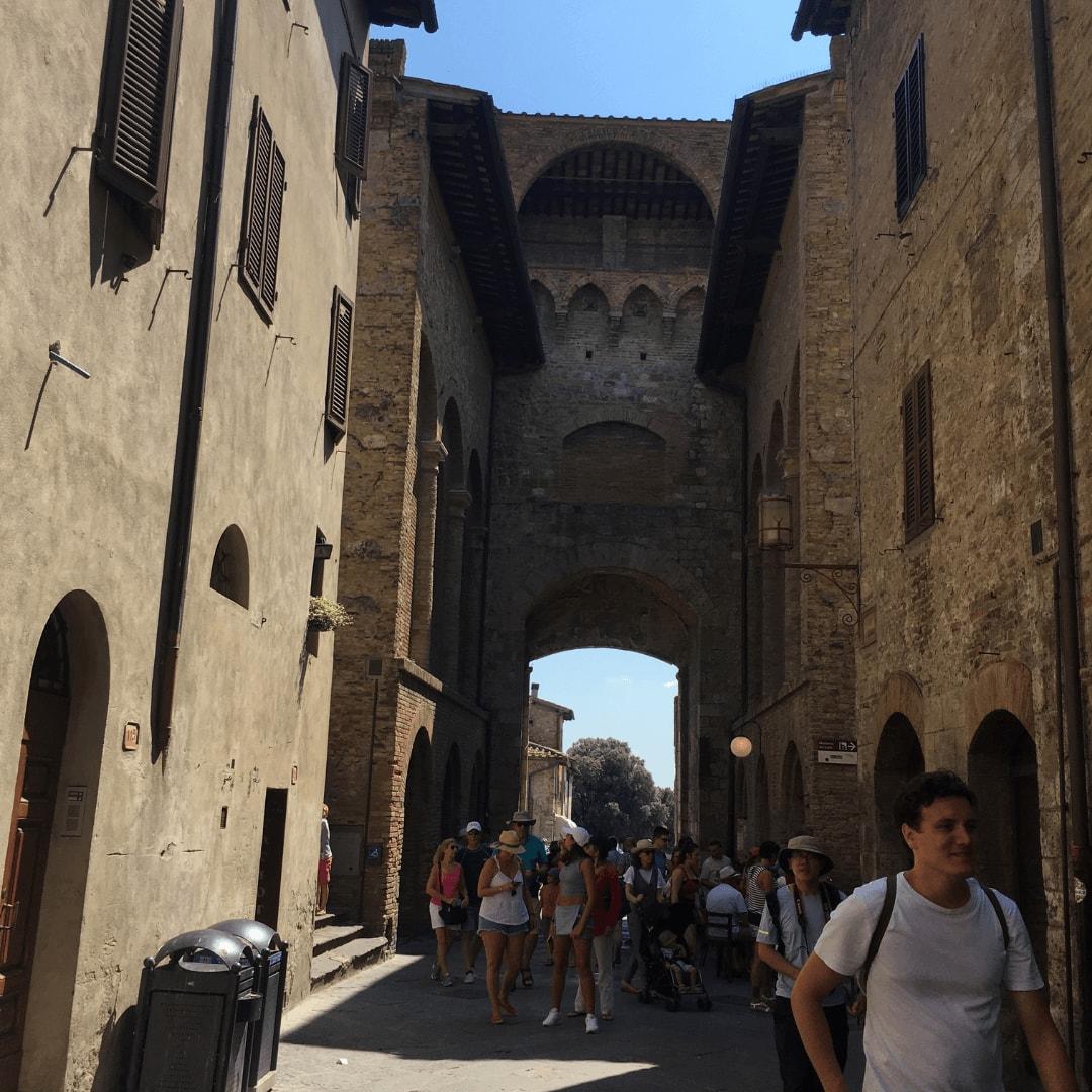people walking in san gimignano