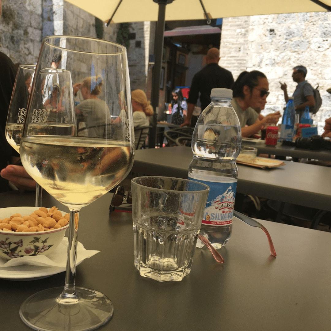 glass of vernaccia the local wine in san gimignano
