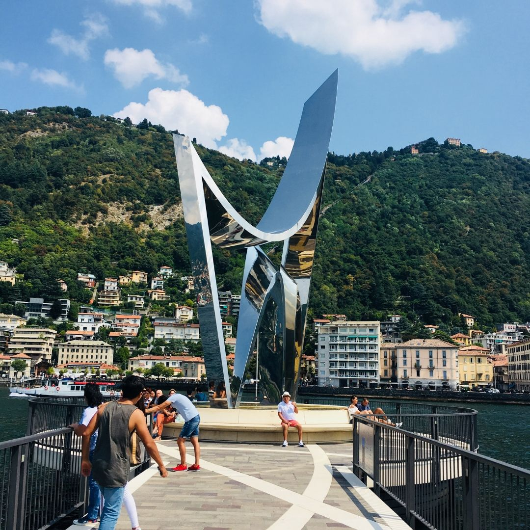 reflective sculpture in the middle of the lake in como