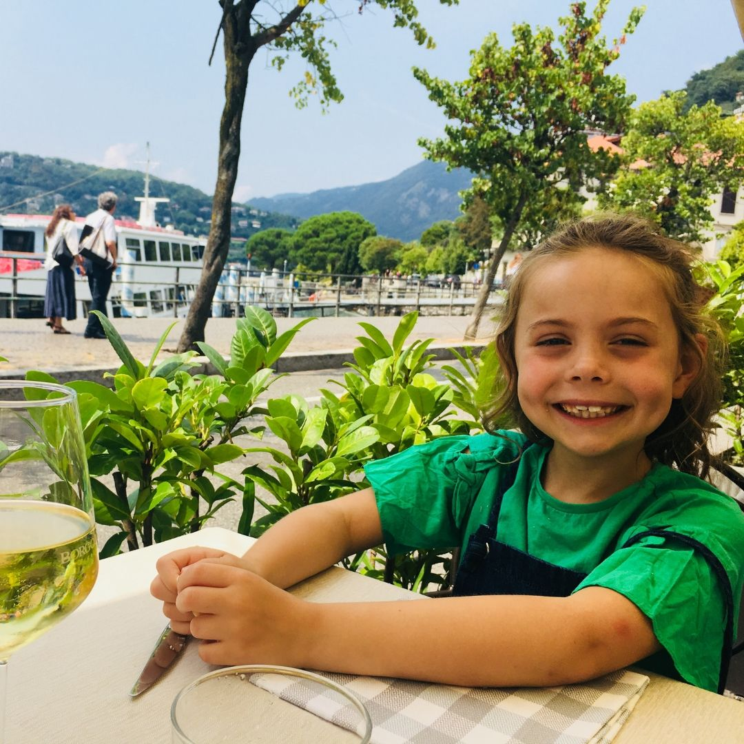 piper quinn in a gorgeous lakeside restaurant in Como, Italy