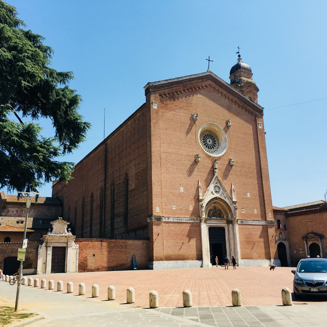 beautiful old red brick church to visit in Tuscany with kids