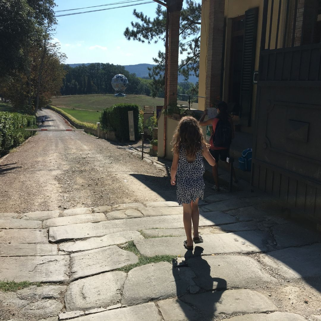 7 year old girl exploring the tuscan countryside at pratolino park
