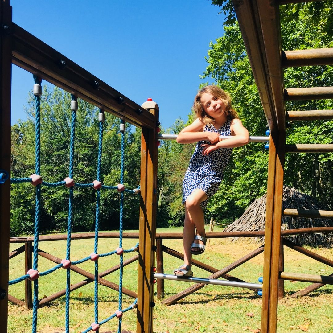 piper quinn at a kids playground in tuscany
